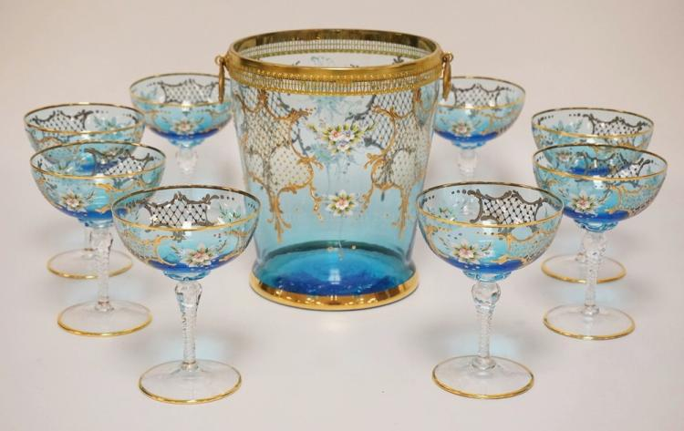 9 PIECE MURANO *CENEDESE* CHAMPAGNE SET INCLUDING AN ICE BUCKET AND 8 CHAMPAGNE GLASSES. EACH PIECE HAVING THICK ENAMELED FLOWERS ALONG WITH INTRICATE GOLD DESIGNS. THE BUCKET HAS A BRASS MOUNTED RIM AND HANDLES. 8 3/4 INCHES HIGH.