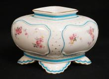 ANTIQUE ROYAL WORCESTER PORCELAIN FLOWER CENTER WITH HAND PAINTED FLOWERS AND BLUE ENAMEL BORDERING. HA A SMALL CHIP ON THE FOOT AND SOME LOSS TO THE BLUE ENAMEL AND GOND TRIM. 9 X 7 INCH DIAMOND SHAPE. 6 INCHES HIGH.