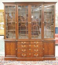 2 PIECE FIGURED MAHOGANY BREAKFRONT BY CENTURY FURNITURE FROM THE *NATIONAL BRITISH COLLECTION* FURNITURE LINE. LIGHTED INTERIOR WITH GLASS SHELF INSERTS. GEOMETRIC FRETWORK DOORS. 77 3/4 INCHES WIDE. 85 INCHES HIGH.