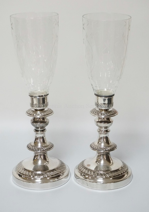 PAIR OF SILVER PLATED CANDLE LAMPS WITH ETCHES GLASS HURRICANE SHADES. 16 1/4 INCHES HIGH. THE COLLARS ON THE SHADES ARE MARKED STERLING.