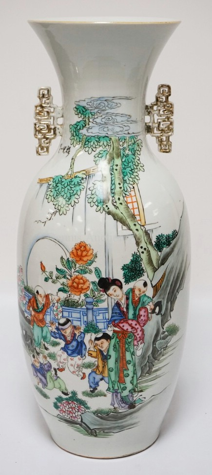 LARGE ASIAN PORCELAIN VASE DECORATED WITH OVERGLAZE DECORATION OF PEOPLE WITH CHILDREN AND FLOWERS. SIGNED ON THE SHOULDER. CALLIGRAPHY ON VERSO. 22 3/4 INCHES HIGH.
