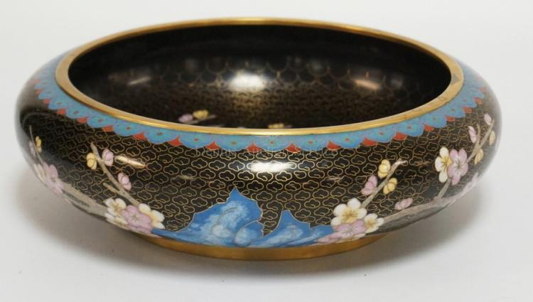 CLOISONNE LOW BOWLDECORATED WITH CHERRY BLOSOMS AND A BIRD. 10 INCHES WIDE. 3 INCHES HIGH.