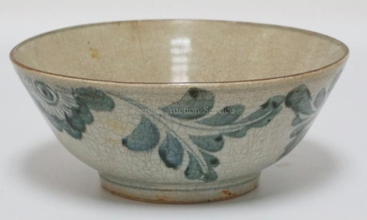 ANTIQUE CHINESE PORCELAIN BOWL WITH A CRAZED FINISH ABLE BLUE DECORATIONS ON THE SIDES AND CENTER. PARTIAL WAX SEAL ON THE BOTTOM. 11 1/4 INCH DIA. 4 5/8 INCHES HIGH. HAS A HAIRLINE.