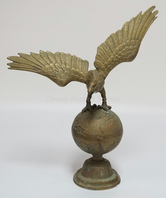 LARGE BRASS FIGURE OF AN EAGLE PERCHED ON A GLOBE. 20 3/4 INCHES HIGH.