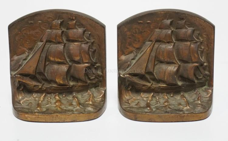 PAIR OF BRONZE BOOKENDS DEPICTING SAILING SHIPS AT SEA. 5 1/2 INCHES HIGH. THE BACKS ARE MARKED *CJO*