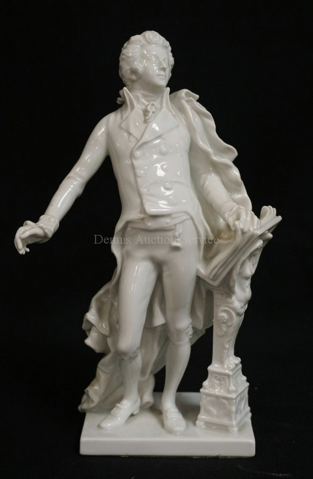 AUGARTEN WIEN PORCELAIN FIGURE OF MOZART NEXT TO A FIGURAL PODIUM. #1841. 10 INCHES HIGH.