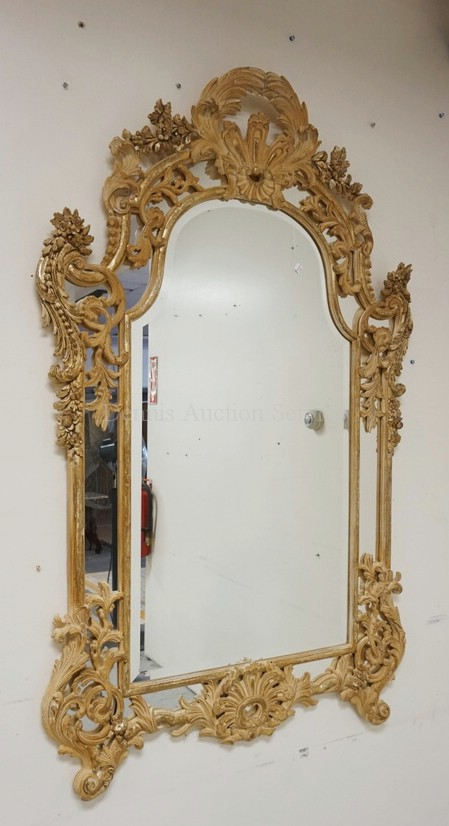 LARGE ORNATELY CARVED MIRROR WITH BEVELED GLASS. 61 X 39 INCHES.