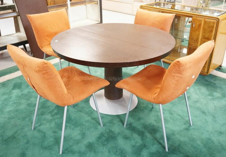 FRENCH MODERN DINING TABLE AND 4 CHAIRS. CHAIRS BY *LIGNE ROSET* AND THE BASE OF THE TABLE IS MARKED *CINNA REGIS ERED* AND MEASURES 47 1/4 INCH DIA. 29 INCHES HIGH.