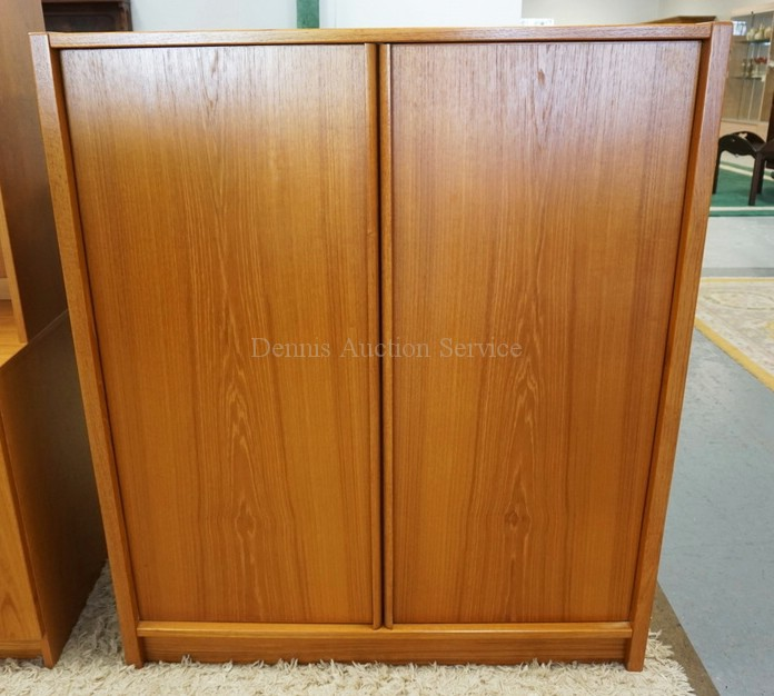 *JESPER* DANISH MODERN 2 DOOR CABINET WITH SHELVES AND DRAWERS ON THE INTERIOR. 40 1/2 INCHES WIDE. 47 INCHES HIGH.