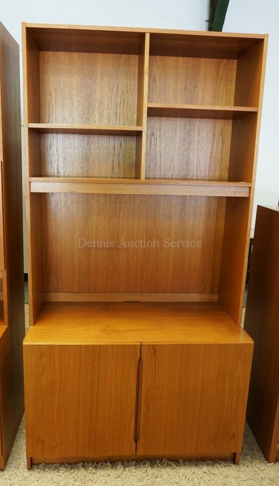 DANISH MODERN CABINET WITH A BOOKCASE TOP. 76 1/4 INCHES HIGH. 39 1/2 INCHES WIDE.