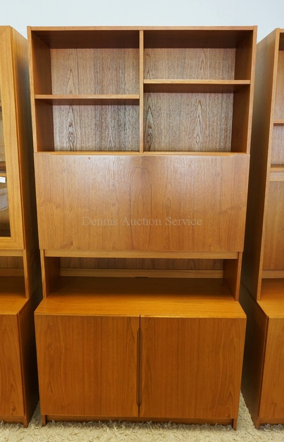 DANISH MODERN CABINET WITH A BOOKCASE TOP HAVING A DROP FRONT DOOR WITH A SHELVED INTERIOR. 76 1/4 INCHES HIGH. 39 1/2 INCHES WIDE.