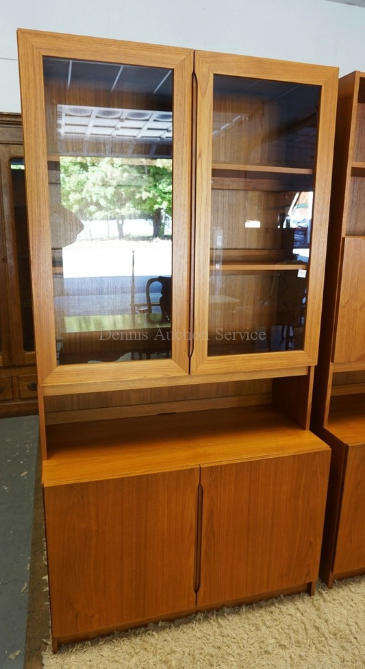 DANISH MODERN CABINET WITH A BOOKCASE TOP HAVING 2 GLASS DOORS AND A SHELVED INTERIOR. 76 1/4 INCHES HIGH. 39 1/2 INCHES WIDE.
