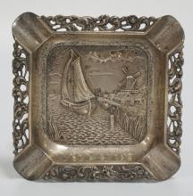 DUTCH STERLING SILVER ASHTRAY DECORATED WITH A SHIP AND WINDMILL.3 5/8 INCHES SQUARE. 2.18 TROY OZ.
