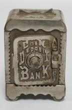 NICKEL PLATED CAST IRON *COIN DEPOSIT* STILL BANK. 4 1/4 INCHES HIGH. 3 INCHES WIDE.
