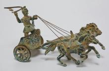 BRONZE FIGURE OF A HORSE DRAWN CHARIOT AND RIDER. 3 1/2 INCHES HIGH.