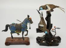LOT OF 2 ENAMEL DECORATED FILIGREE METAL FIGURES. ONE HORSE ON A WOODEN BASE, THE OTHER IS 2 BIRDS ON A LACQUERED TREE AND HAS A WING TIP TAPED BACK ON. TALLEST IS 6 3/4 INCHES HIGH.