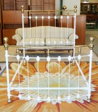 IRON AND BRASS BED IN WHITE PAINT. FULL SIZE. 62 INCHES HIGH.