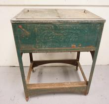 VINTAGE COCA COLA COOLER IN GREEN. HAS WEAR. 31 1/2 X 23 1/2 AND 40 INCHES HIGH.
