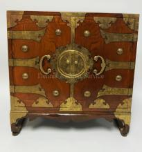 ASIAN BRASS BOUND 2 DOOR CABINET. 23 INCHES HIGH. 22 INCHES WIDE.