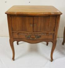 DAVIS FURNITURE NIGHTSTAND WITH A 2 DOOR CABINET OVER ONE DRAWER. 27 1/2 INCHES HIGH. 23 INCHES WIDE.