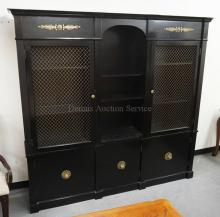 EBONIZED 2 PIECE CHINA CABINET WITH METAL MESH PANELED DOORS AND BRASS ACCOUTREMENTS. 86 INCHES LONG. 81 INCHES HIGH.
