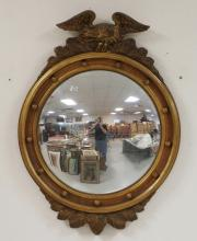 FEDERAL STYLE BULLSEYE MIRROR WITH AN EAGLE CREST. 31 X 22 1/2 INCHES.