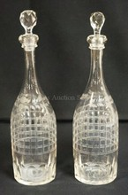 PAIR OF CUT AND ENGRAVED DECANTERS W/APPLIED LIP AND POLISHED PONTILS. CUT STOPPERS PROBABLY ORIGINAL. 14 IN H.