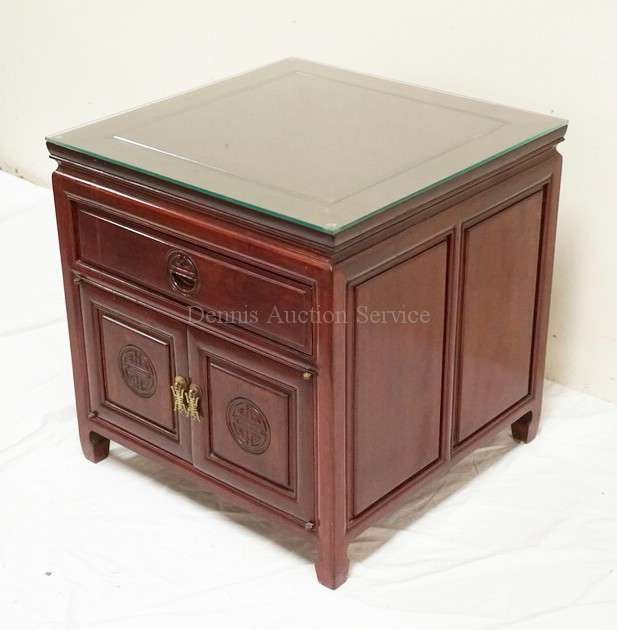 Carved asian style end table with one drawer over doors