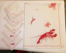 TABLECLOTH AND 12 NAPKINS W/ LOBSTER, SHRIMP AND CRAB DESIGN. CLOTH IS 8 1/2 FT X 5 3/4 FT