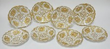 SET OF 8 GOLD DECORATED MEISSEN PLATES W/ RELIEF FRUIT DECORATION. 5 HAVE CHIPS ON THE BOTTOM BASE RIMS. NO SCRATCHES THROUGH THE MARKS. 8 3/4 IN