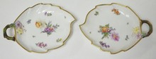 PAIR OF ROYAL COPENHAGEN LEAF FORM DISHES W/ APPLIED FLOWERS AND TWIG HANDLES. NO 1221/1597. NO SCRATCHES IN THE MARKS. Y IN ROYAL UNDERLINED. 7 1/4 IN X 5 1/2 IN