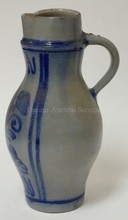BLUE DECORATED STONEWARE PITCHER. HAS BLUE NO. 4  14 1/4 IN H