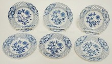 SET OF 6 BLUE AND WHITE MEISSEN OPEN EDGE 5 7/8 IN PLATES. ALL HAVE SCRATCHES THROUGH THE MARKS.