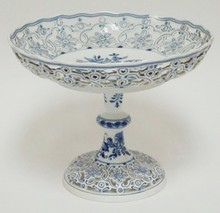 LARGE BLUE AND WHITE MEISSEN BOLTED OPEN EDGE COMPOTE. NO SCRATCHES IN THE MARK. 10 3/4 IN DIA, 8 1/4 IN H
