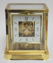 LE COULTRE ATMOS CLOCK. 8 IN WIDE, 9 1/8 IN H. HAS A PRESENTATION PLAQUE ATTACHED.