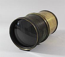 Big camera lens objective, laquered brass, sigend