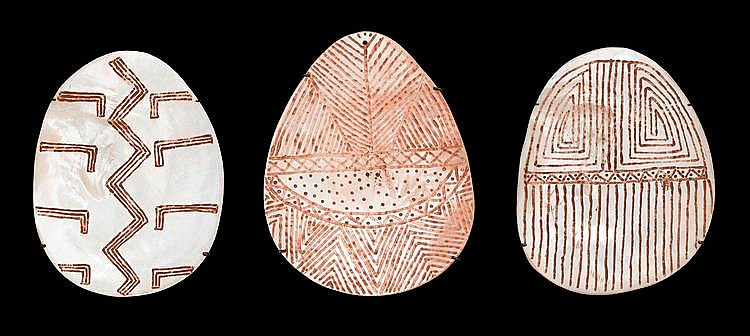 AUBREY TIGAN, born 1945, THREE RIJI (PEARL SHELL PENDANTS), incised pearl shells with natural earth pigments
