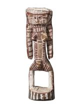 ENRAELD DJULABINYANA MUNKARA, (1882 – 1968), DOUBLE-SIDED FIGURE REPRESENTING BIMA AND PURUKAPALI, c.1955, natural earth pigments on carved ironwood