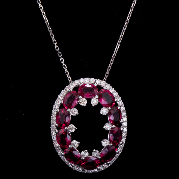 18K GOLD FANCY PENDANT W/ 1.82ct. RUBY & 0.34ct. WHITE