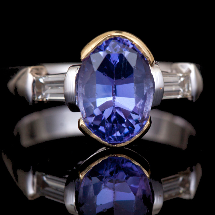 18K GOLD RING W/ 0.40ct. DIA. 2.63ct. TANZANITE
