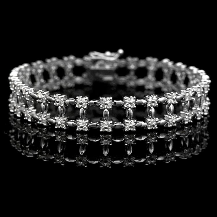 18K GOLD LADY'S BRACELET W/ 2.75ct. DIAMOND