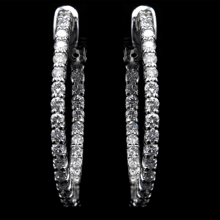 14K GOLD IN AND OUT EARRINGS W/ 1.20ct. DIA