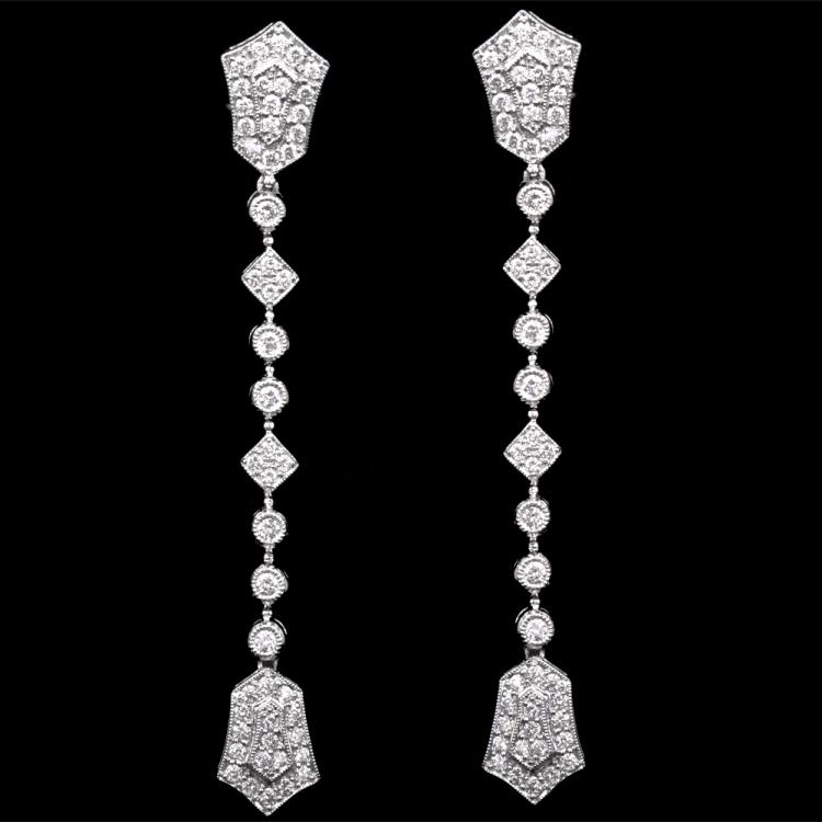 18K GOLD DANGLE EARRINGS W/ 1.37ct. DIAMOND