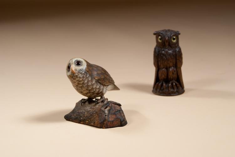 Small carved owl perched on a log.