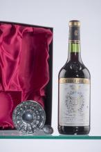 1 coffret comprenant 1 Château Gruaud-Larose 1976 Saint Julien  + 1 tastevin.