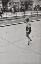 * Cartier-Bresson (Henri, 1908-2004). A one-legged boy on crutches in Berlin, 1951,