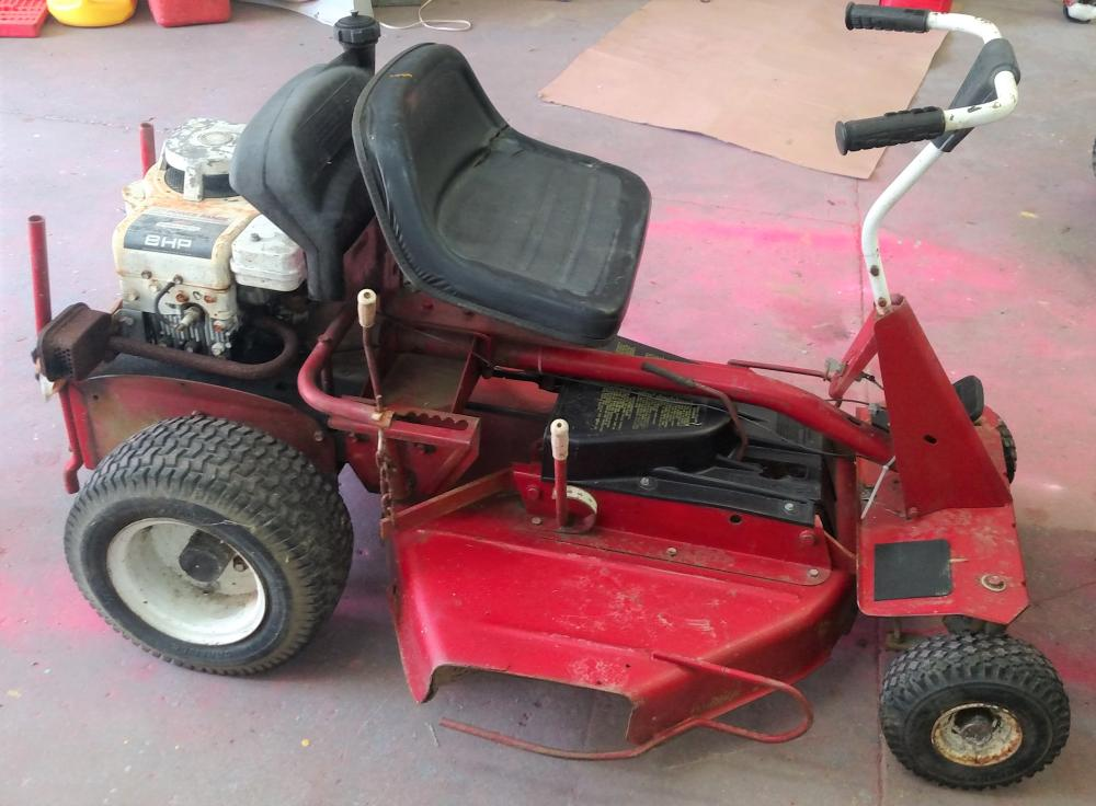 older snapper riding mower- needs a little work