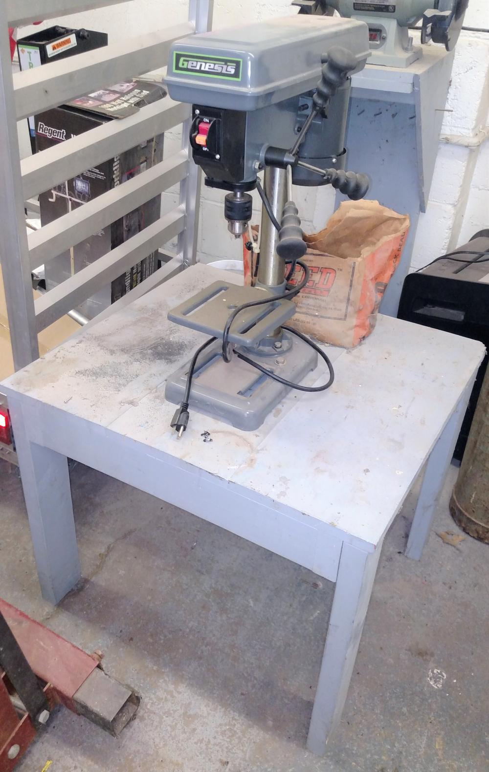 "genesis 8"" 5 speed drill press attached to wood stand"