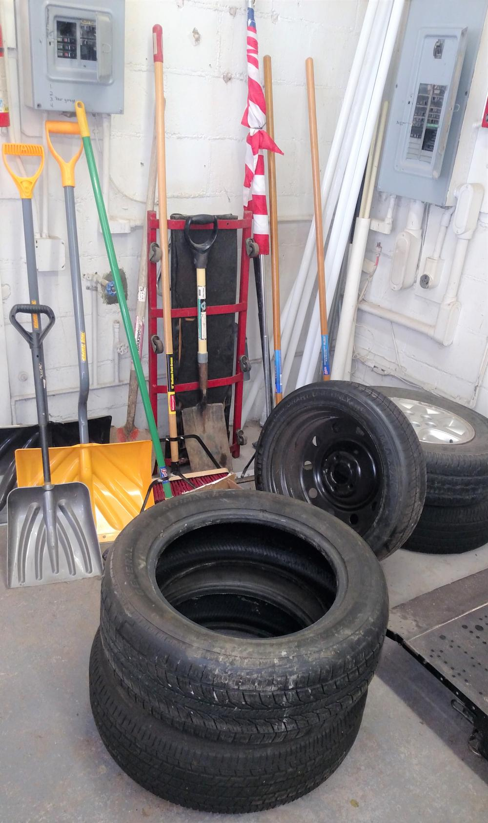 tool joblot-- shovels, spade, usa flag, car creeper, tires (1 w/rim)
