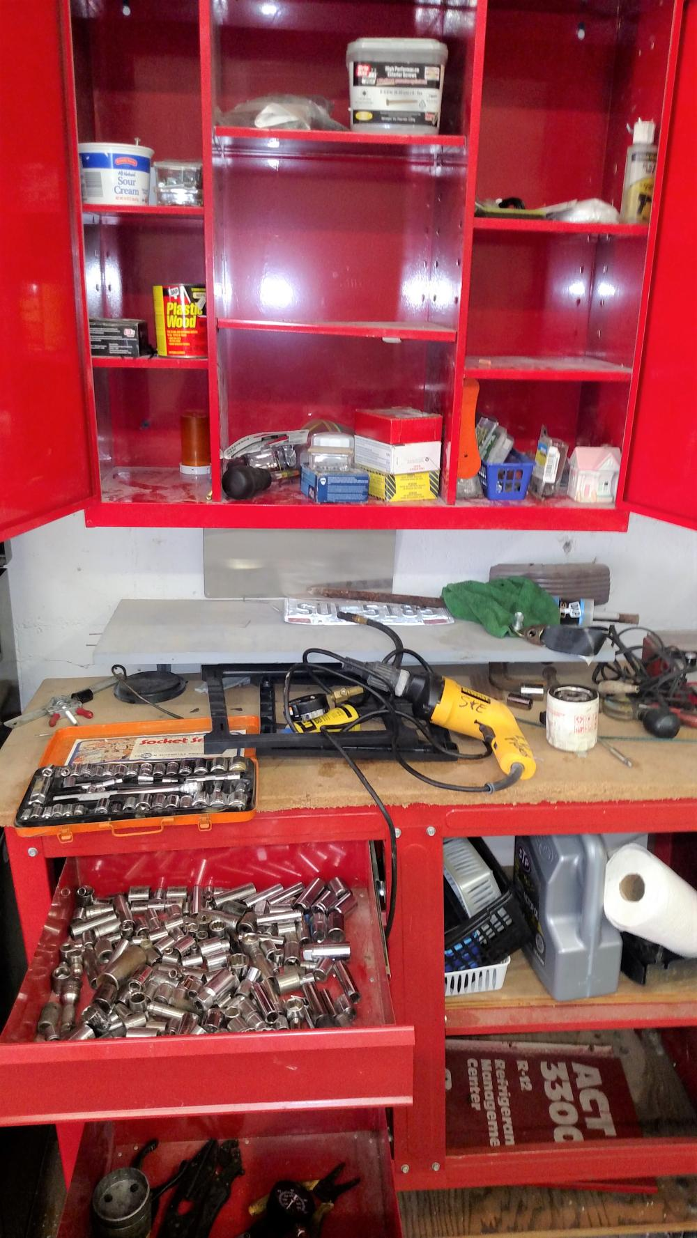 red tool box contents (top and bottem)-- sockets, screwdrivers, dewalt drywall drill, nails, screws, nuts & bolts-- contents only